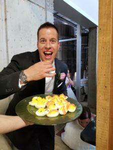 groom eating deviled egg